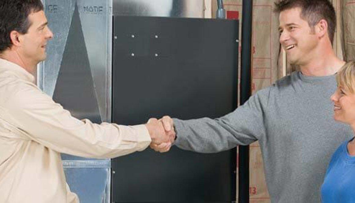 Furnace technician shakes hand