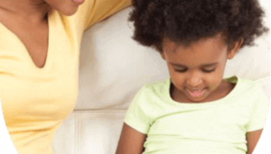 Mom reads book with boy
